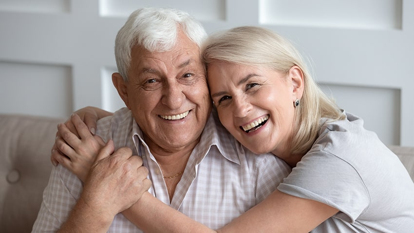 Happy older couple spend time with each other in their home