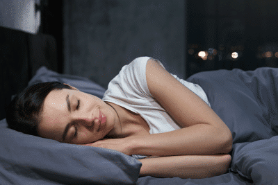 woman getting a restful night without snoring with sleep apnea treatment
