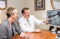 Dr. Kuh with patient discussing X-Rays in Aberdeen