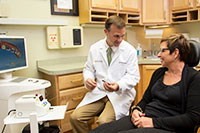 Dr. Kuhn discussing Non-surgical laser therapy for gum disease with patient in Aberdeen