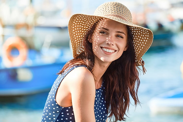 Woman in summer hat with a big smile