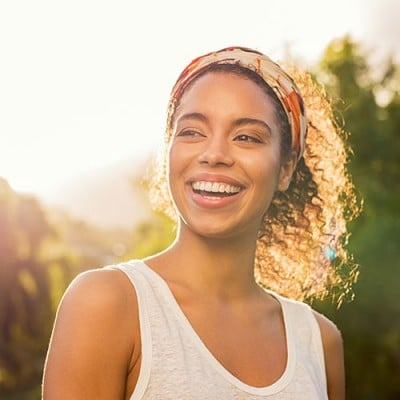 Smiling woman in the sunshine