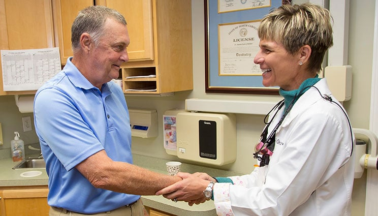 Dr. Grimshaw shaking hands with patient after TMJ Treatment in Aberdeen