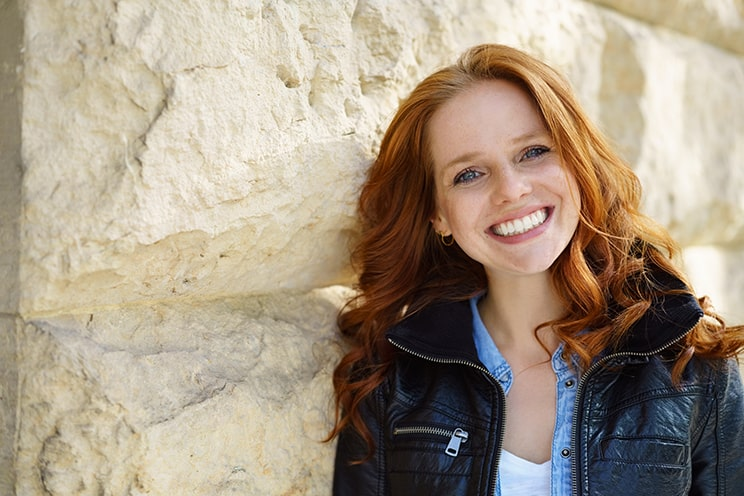 Porcelain Veneers gave this young red haired woman a beautiful smile