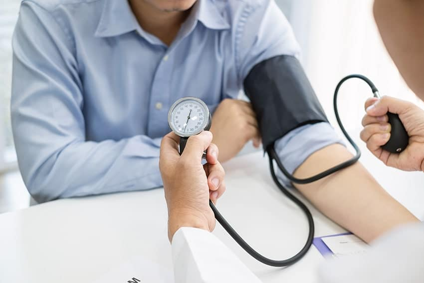 man having his high blood pressure checked