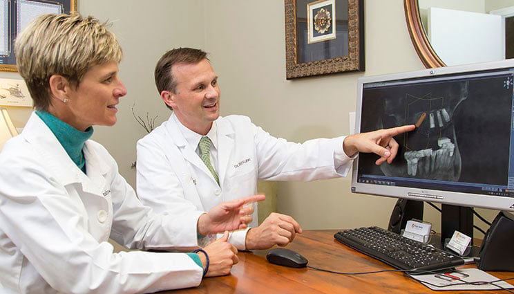 Dr. Grimshaw and Dr. Kuhn reviewing x-rays for full mouth restoration in Aberdeen