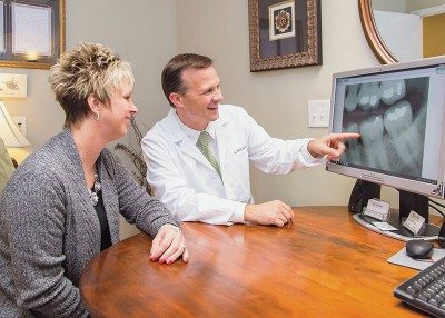 Dr. Kuhn reviewing digital x-rays with patient for preventative dentistry